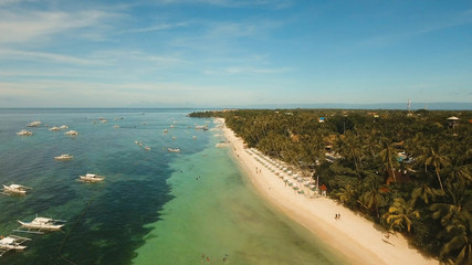 Foto auf Leinwand Tropical strand Aerial view of tropica Alona beach on the island Bohol, resort, hotels, Philippines. Beautiful tropical island with sand beach, palm trees. Tropical landscape. Seascape: Ocean, sky, sea. Travel