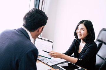 Business manager inviting new worker to sign work contract