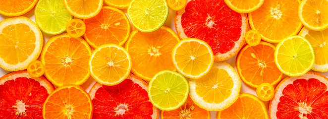 beautiful fresh sliced mixed citrus fruits like background, concept of healthy eating, dieting, top view Fototapete