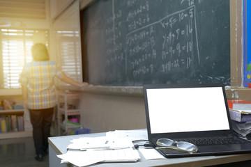 Teacher is teaching mathematics