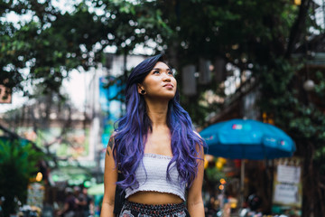 Woman with purple hair on street