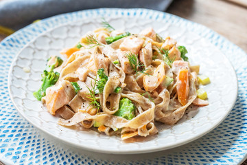Pasta with salmon in a creamy sauce