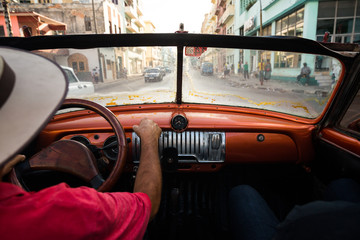 Close-up of man driving a vintage car on the street