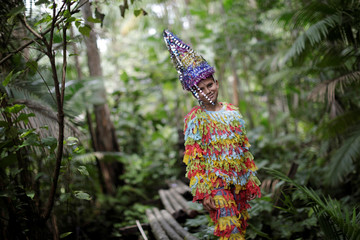 """A member of the """"Bloco Bambas da Folia"""" group poses for photo during Carnival of the Waters, where costumed and colorful boats navigate the river Pacaja, around the islands near the city of Cameta"""