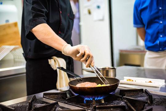 Chef preparing food on stove