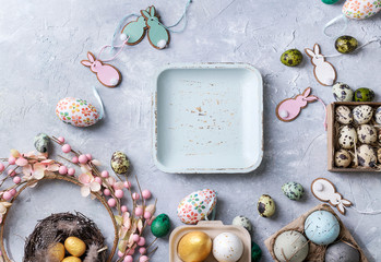 Easter decoration with colored quail and chicken eggs