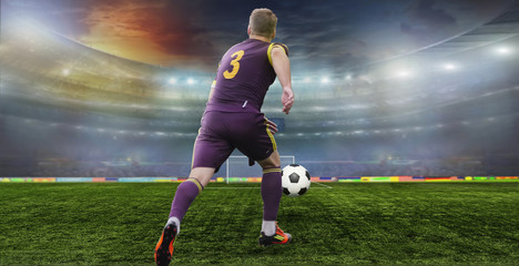 Wall Mural - Soccer ball on the field of stadium