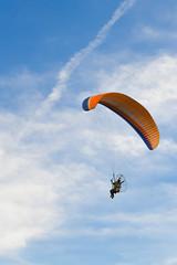 The para motor fly over blue sky