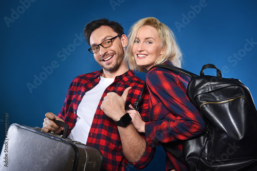 Happy smiling couple of handsome bearded funny man in glasses and blonde  woman in a cowboy bc9ead6fa731