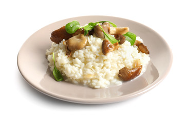 Plate with risotto and mushrooms on white background