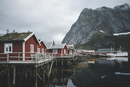 Houses at waterfront of still lake