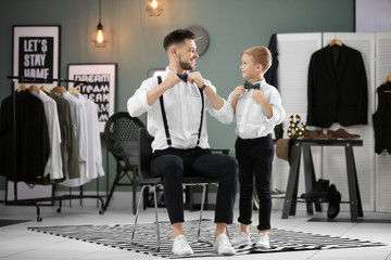 Father and son in elegant suits, indoors