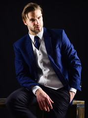Businessman in formal wear with unshaven face and stylish haircut