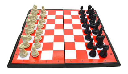 Chess board set up to begin a game. Isolated on white background