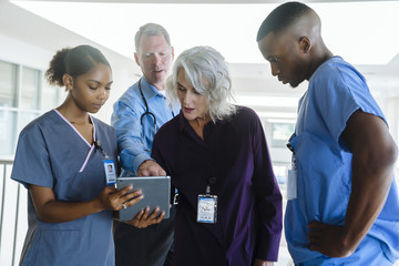 Doctors and nurses using digital tablet