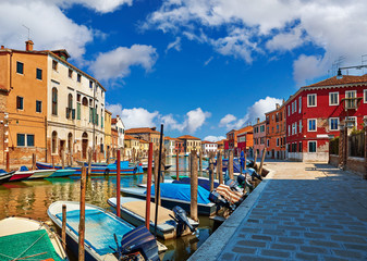 Fototapete - Burano island in Venice Italy over canal with boats among old