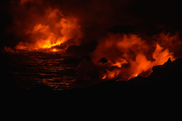 Smoke from molten lava at night