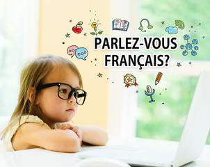 Parlez Vous Francais text with little girl using her laptop
