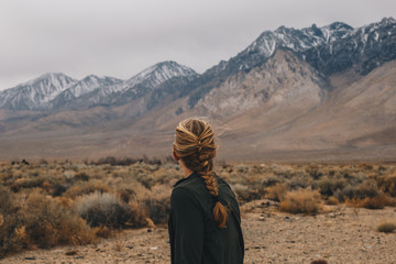 Blonde Woman with Braid in the Mountains