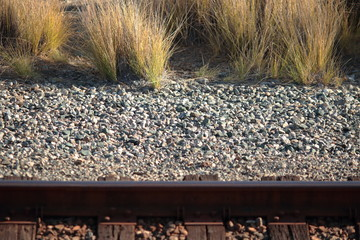rails stones and laterally grass grey brown wood background texture