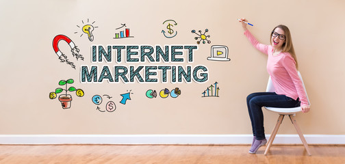 Internet Marketing with young woman holding a pen in a chair