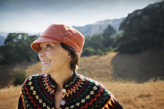 Smiling Caucasian woman wearing hat outdoors