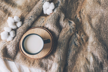 Cup of coffee with cozy blanket