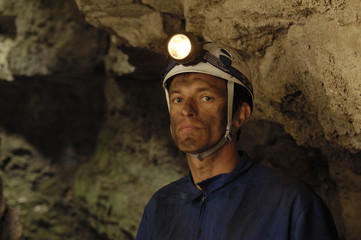 portrait of a miner inside a mine