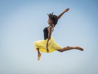 Black woman dancing and jumping