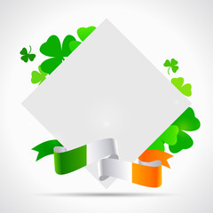 St. Patrick's day background with clover, paper and irish flag on white