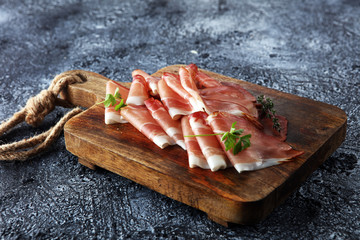 Italian prosciutto crudo or jamon with parsley. Raw ham