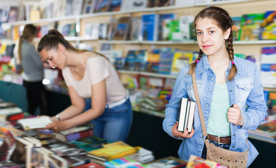 Ordinary girl holding chosen book in hands