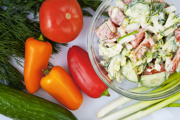 Vegetable salad, pepper, cucumber, tomato, dill, onion, mayonnaise.