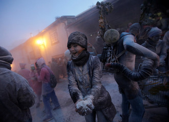"""Revellers participate in a flour fight during the """"O Entroido"""" festival in Laza village"""
