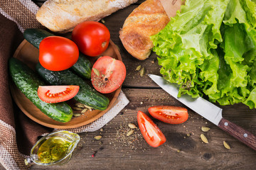 tomato, cucumber, lettuce, baguette, olive oil and spices