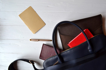 Business bag and empty paper on the desk. Business flat lay.