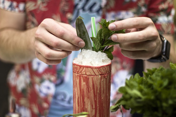 The barman is making tropical cocktails