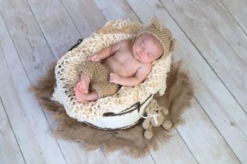 Baby Boy Wearing a Bear Hat