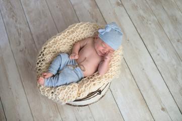 Baby Boy Sleeping in a Bucket