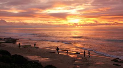 Beachcombers at La Jolla, San Diego, California, watch the sunset