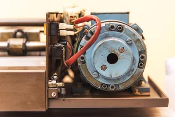 Old paper cutting machine gear inside of a print shop