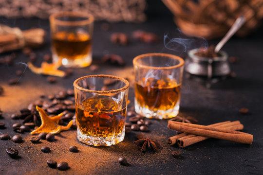 Whiskey, brandy or liquor, spices, anise stars, coffee beans, cinnamon sticks