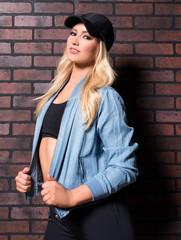 Beautiful Blonde Woman in Sports Wear and Baseball Hat