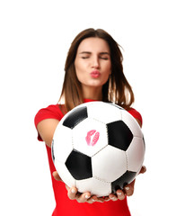 Fan sport woman player in red uniform hold soccer ball celebrating kissing