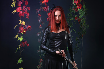 Blue Eyed Red Head Gothic Girl Pulling out a fantasy sword among autumn vines
