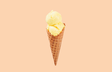 Vanilla ice cream cone on white background.