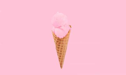 Strawberry ice cream cone on white background.
