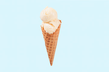 Vanilla ice cream cone on white background.