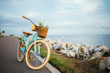 Foto op Canvas Fiets Bicycle by the beach