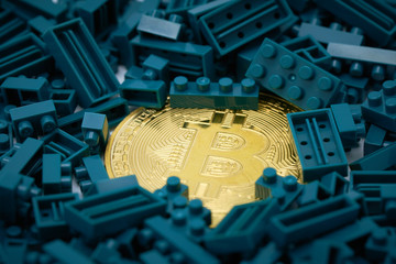 a gold bit coin in the middle of a green jug block. Communications to Invest in the Digital Market.using as background business concept with copy space.